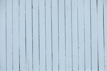 Vintage white wood background texture with knots and nail holes. Old painted wood wall. White abstract background. Vintage wooden dark horizontal boards. Front view with copy space