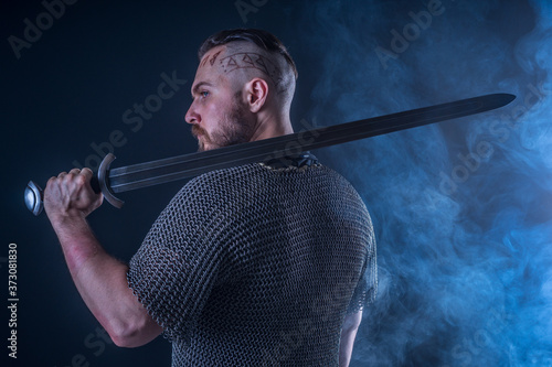 Studio photography: half-length portrait of a Viking in chain mail and holding a Canvas Print