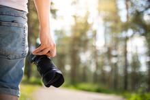 Photographer Holding A Camera ...