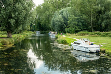 A Lovely View Looking Down River From Horstead Mill With Boats Moored Up On A Summers Day In Norfolk  England