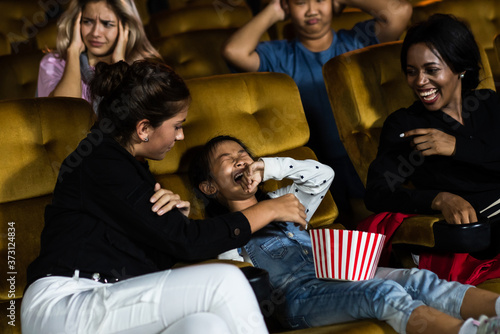 Photo The girls cried loudly in the cinema, causing annoyance to the people sitting next to and behind them