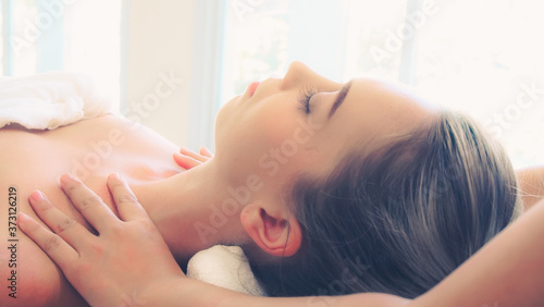 Obraz na plátně Relaxed woman getting shoulder massage in luxury spa by professional massage therapist