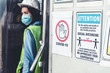 canvas print picture - Caution sign in factory warning to industry labor worker to prevent Covid-19 Coronavirus spreading during job business reopening period after epidemic crisis . Working safely concept .