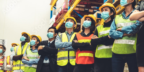 Cuadros en Lienzo Group of factory industry worker working with face mask to prevent Covid-19 Coronavirus spreading during job reopening period