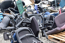 Piles Of Discarded Chairs And ...