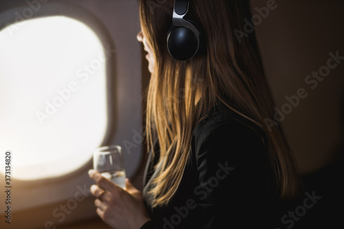 Fototapeta Attractive woman in private jet