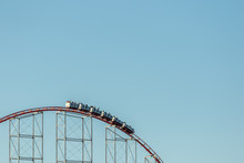A Roller Coaster At The Top Of A Hill