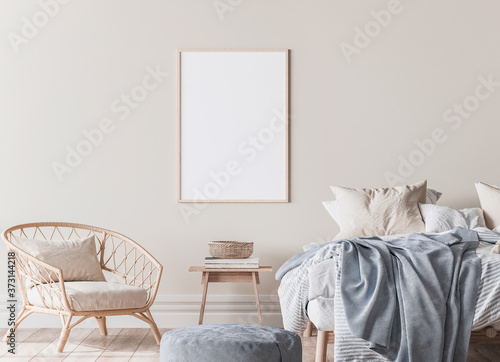 Foto frame mockup in Scandinavian bedroom design, wooden bed, blue plaid, and rattan armchair