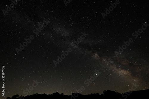 Fotografiet Low angle shot of a beautiful starry night sky
