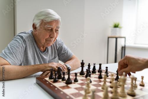 Fototapeta Elderly Senior Playing Chess