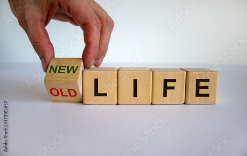 Fototapety, obrazy: Hand is turning a cube and changes the words 'old life' to 'new life'. Beautiful white background. Business concept, copy space.
