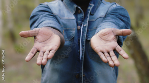 Fototapeta African man showing the palm of his hands
