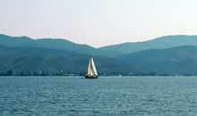 A Lonely Sailboat Sailing On T...