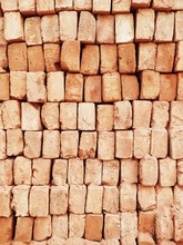 A Stack Of Red Bricks Fills Th...