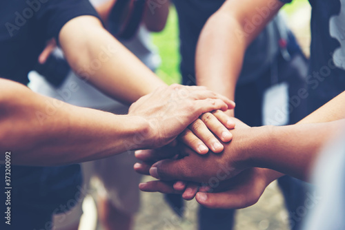 Solidarity unite people hands together community teamwork Fototapet