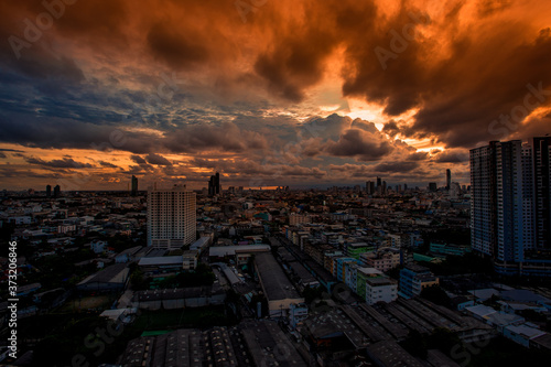 Fototapeta The high angle background of the city view with the secret light of the evening,