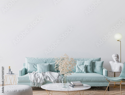 Obraz Trendy modern living room in light turquoise color and golden home accessories, empty wall mockup, 3d render - fototapety do salonu