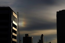Part Of Sundog In The Evening At Sunset In The City. Low Key. Nature And Building Background Concept.