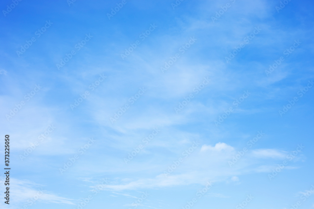 Fototapeta Blue sky background and white clouds soft focus, and copy space