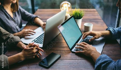 Obraz Photo of male hands with laptop. Blank screen, Mock-up - fototapety do salonu