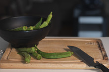Closeup Shot Of A Bowl Of Okra And A Knife