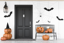 Carved Pumpkins Near Black House Door
