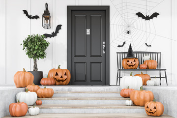 Carved pumpkins on stairs of white house