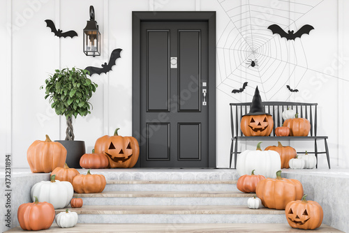 Fototapeta Carved pumpkins on stairs of white house