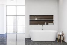 White Bathroom With Tub And Wi...