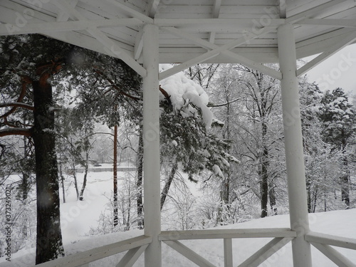 Fototapeta White Chinese style gazebo perched on a rock in winter in the snow