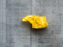Thrown Yellow Fabric In Front Of Concrete Wall