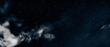 Stars And Sky With Clouds At N...