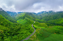 Aerial View Of Beautiful Sky Road Over Top Of Mountains With Green Jungle In Nan Province, Thailand.