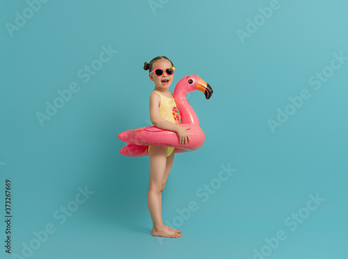 Happy child wearing swimsuit