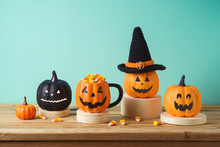 Halloween Holiday Concept With Jack O Lantern Glitter Pumpkin Decor And Candy Corn On Wooden Table Over Blue Background