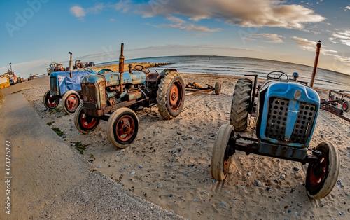 Fisheye view of tractors on Cromer beach on the North Norfolk coast Canvas Print