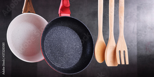 Two hanging frying pans and kitchen utensils Canvas