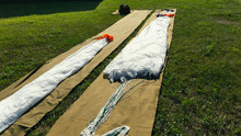 The Parachute Lies On The Grass For Assembly And Further Jump