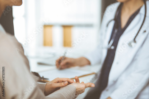 Fotografija Doctor and patient discussing current health examination while sitting in clinic