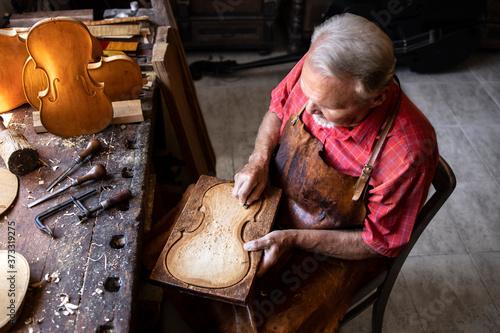 Top view of senior carpenter working in his old-fashion workshop Fotobehang