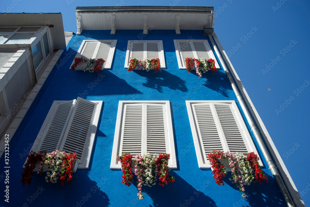 Fototapeta Traditional old greek house with blue door and windows, traditional door and windows colored