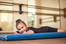 Kid At Gymnastic Class Doing Exercises. Children And Sport Concept