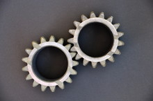 Metal Cogs Cogwheels On A Dark...