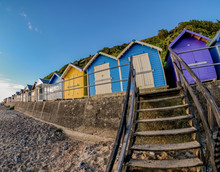 Row Of Colourful Beach Huts On...