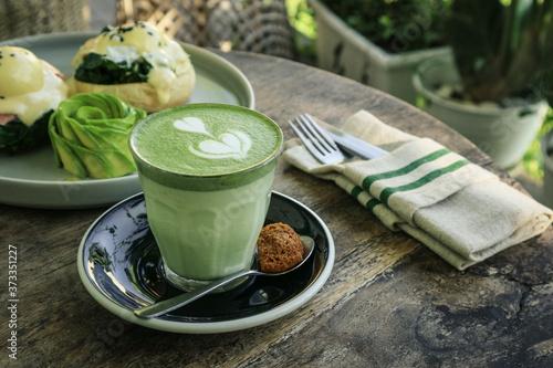 Fototapeta Matcha latte with latte art on top