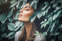 Beautiful Fashion Model Girl Enjoying Nature, Breathing Fresh Air In Summer Garden Over Green Leaves Background. Harmony Concept