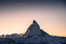 Scenic View On Snowy Matterhorn Peak In Sunrise, Switzerland.