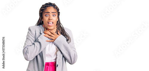 Photo Young african american woman with braids wearing business clothes shouting and suffocate because painful strangle