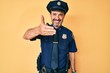 canvas print picture - Middle age hispanic man wearing police uniform smiling friendly offering handshake as greeting and welcoming. successful business.