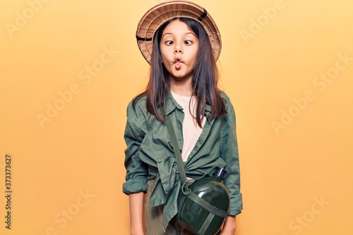 Beautiful child girl wearing explorer hat making fish face with lips, crazy and comical gesture Canvas Print
